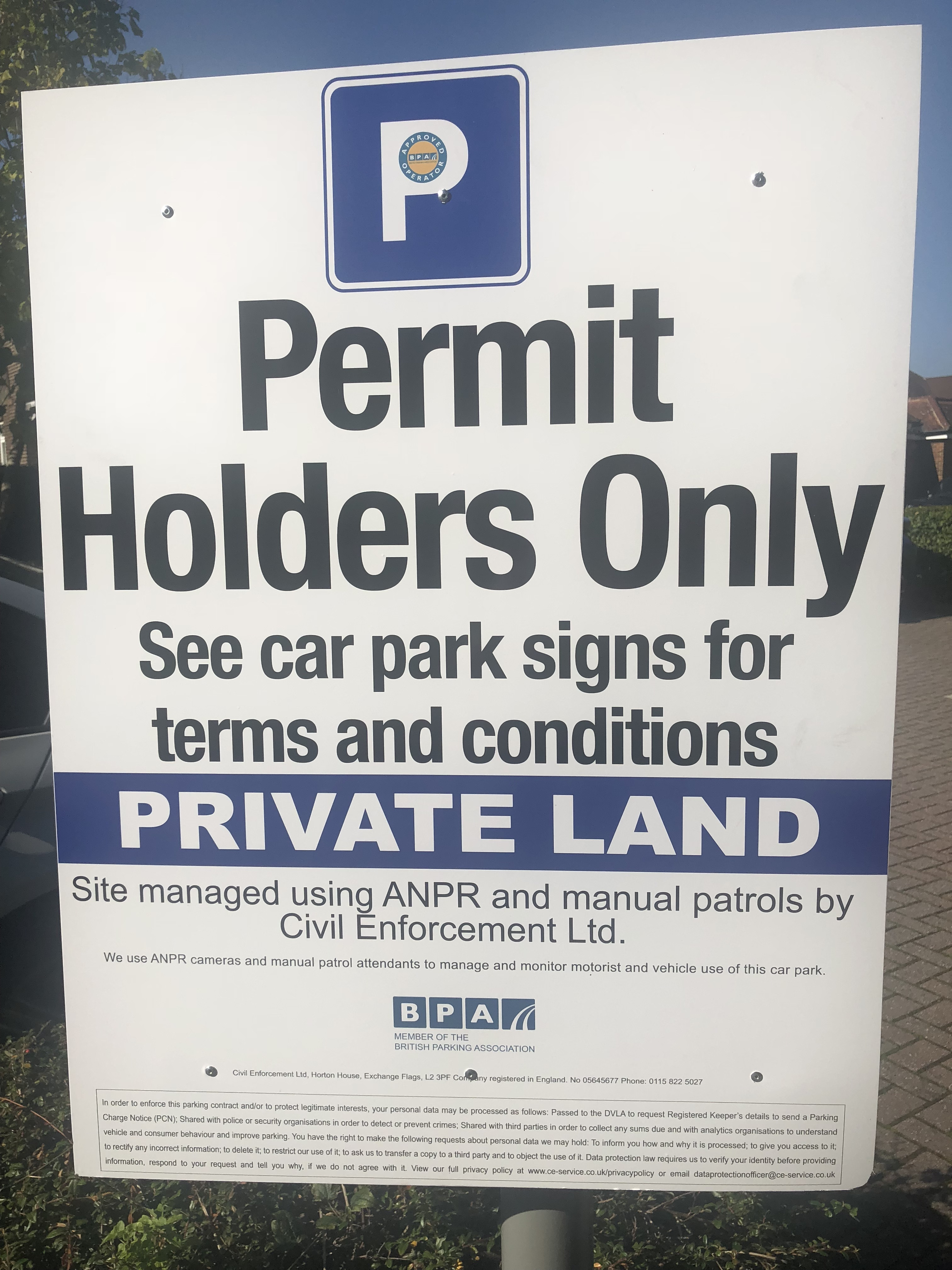 Image of the car parking sign in the practice car park. The sign says Permit holders only. See car park signs for terms and conditions.